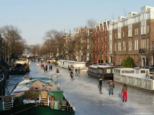 Ice skating on Prinsengracht canal in Amsterdam