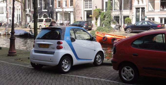 Amsterdam Version Of Smart Car Tipping Into The Canals