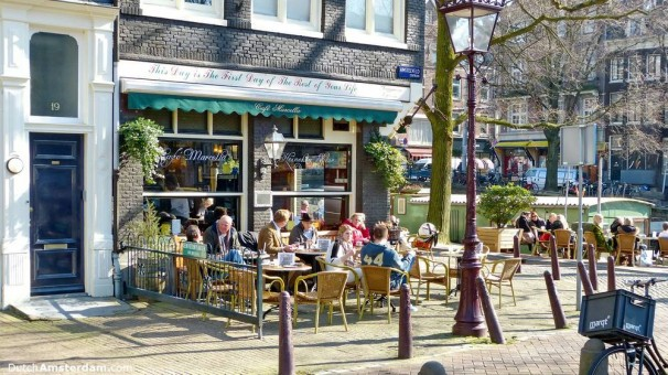 Customers take to the terrace of Café Marcella at Amstelveld, Amsterdam on a spring-like day in March