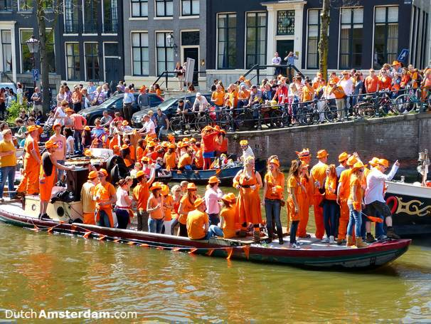 On Queen's Day (King's Day, from 2014), wear something orange, find a boat, and sail the canals