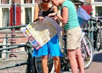Tourists reading Amsterdam map