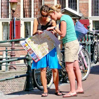Tourists reading Amsterdam map