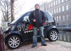 Smart car at Amsterdam canal
