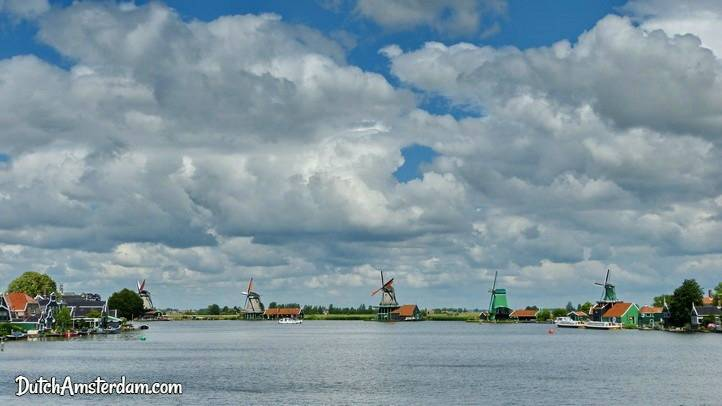 Windmills and cloudy sky