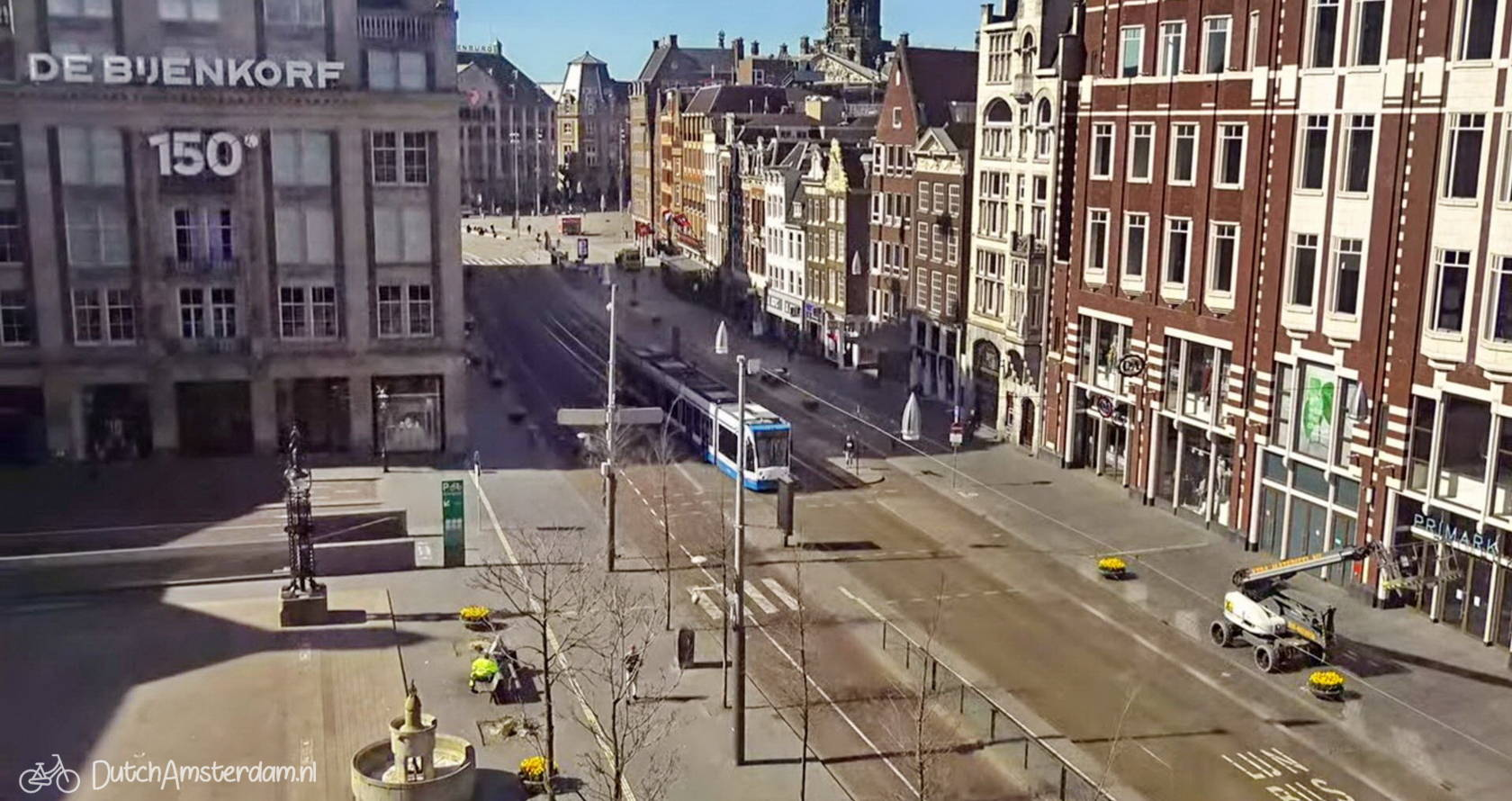 Damrak, the main street between Amsterdam Central Station and Dam square is nearly empty a result of the Coronavirus lockdown.