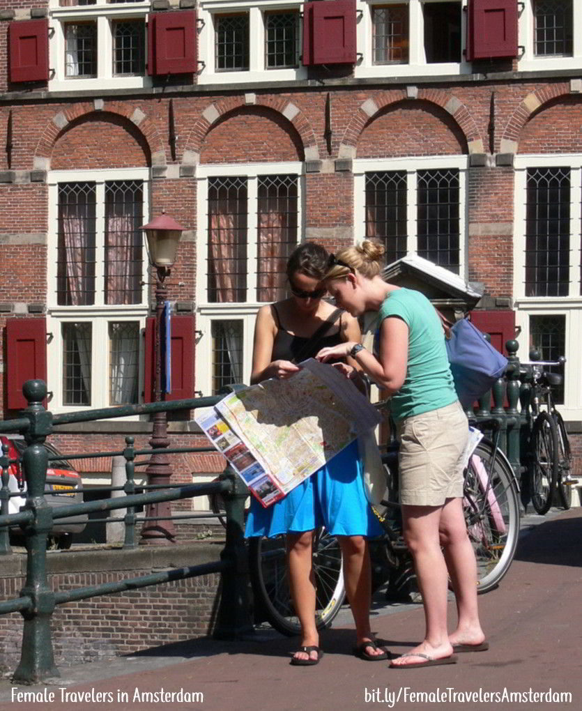 Two women looking at a map of Amsterdam