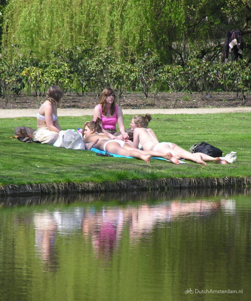 Young women relaxing at Vondelpark in Amsterdam