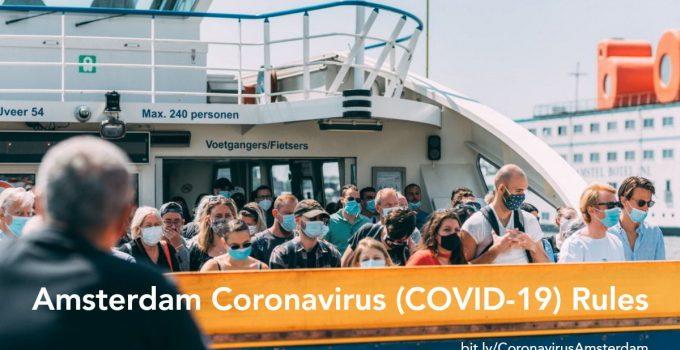 People wearing face masks on board a public transport ferry in Amsterdam