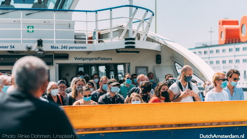 Ferry passengers in Amsterdam wearing face masks