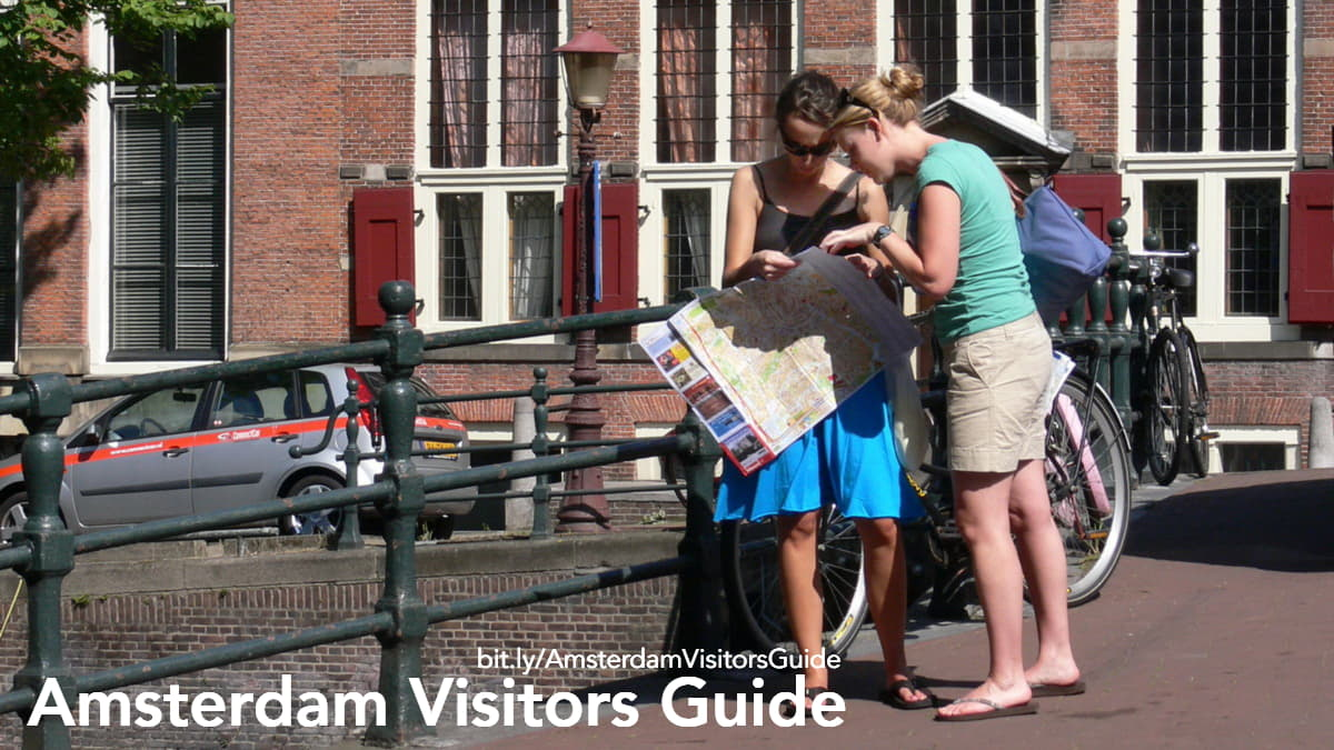 Two girls consult a map of Amsterdam
