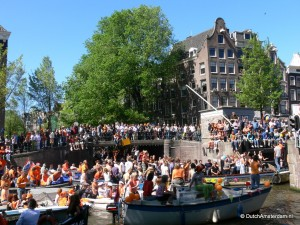 Many people take to Amsterdam's canals on Queen's Day
